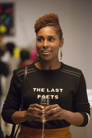 "Issa Rae, in a scene from the HBO series ""Insecure,"" has an essay in ""American Like Me."""