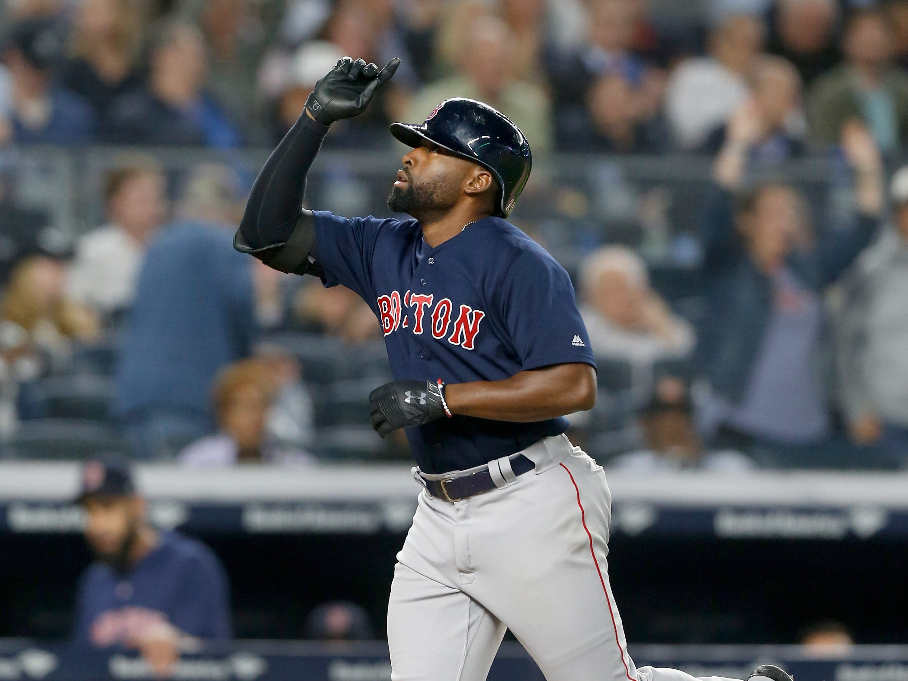 Jackie Bradley Jr. rounds the bases after a seventh inning home run.