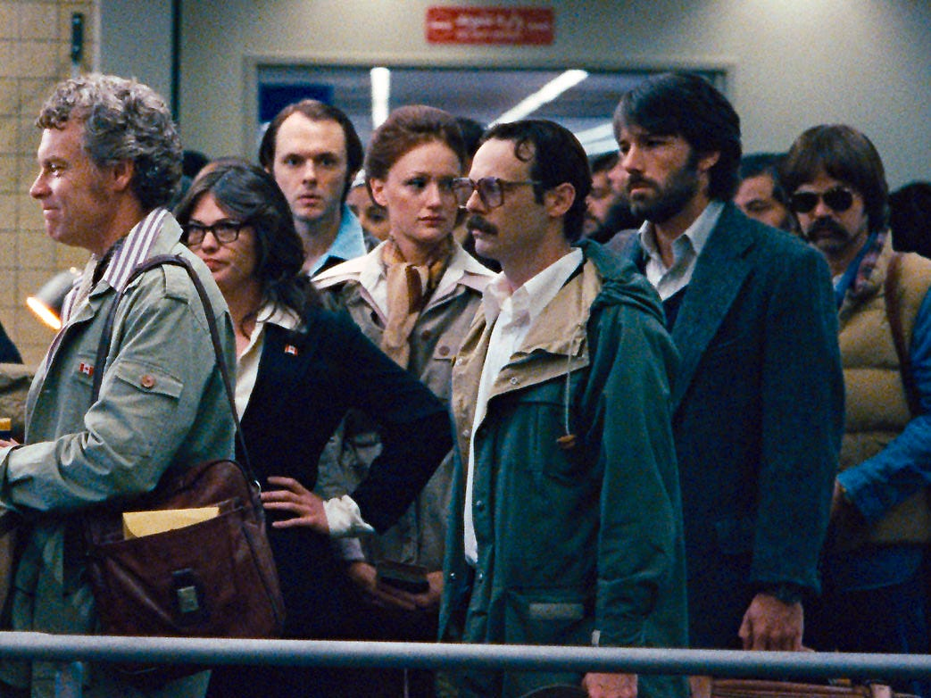 "(L-r) TATE DONOVAN as Bob Anders, CLEA DuVALL as Cora Lijek, CHRISTOPHER DENHAM as Mark Lijek, KERRY BISHÉ as Kathy Stafford, SCOOT McNAIRY as Joe Stafford, BEN AFFLECK as Tony Mendez and RORY COCHRANE as Lee Schatz in a scene from the motion picture ""Argo."" Photo by Warner Bros. Pictures [Via MerlinFTP Drop]"