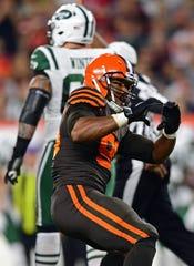 Cleveland Browns defensive end Myles Garrett celebrates after sacking New York Jets quarterback Sam Darnold.