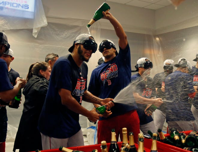 The Red Sox celebrate their third straight AL East title.
