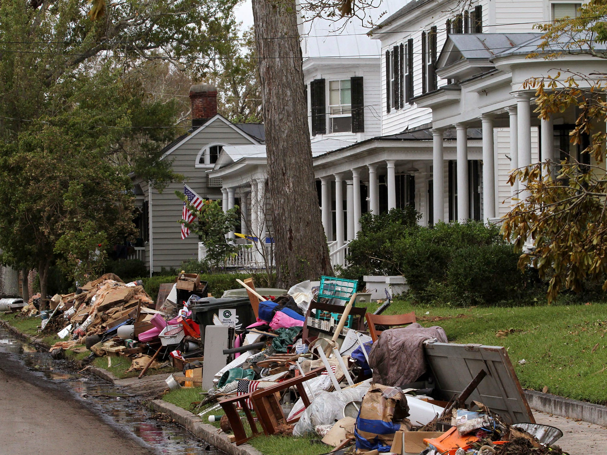 Storm damaged items and debris are piled in front of homes in the historic district in New Bern, N.C. on Sept. 20, 2018.