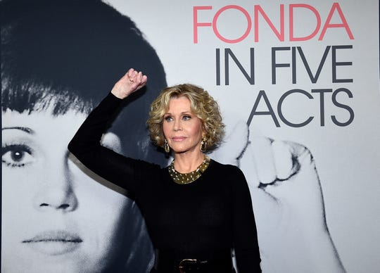 Jane Fonda mimics a protest pose from earlier in her fascinating life at a Los Angeles screening last week for the upcoming HBO documentary, 'Jane Fonda in Five Acts.'