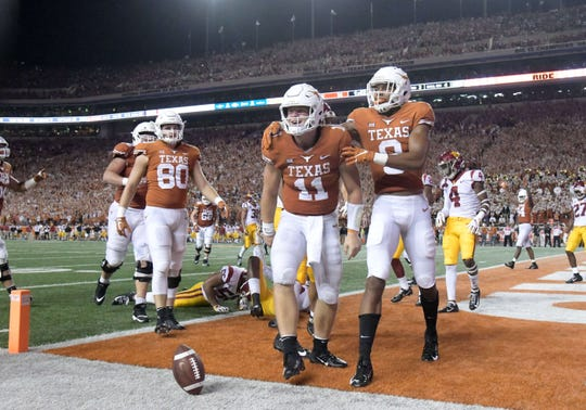 Texas quarterback Sam Ehlinger celebrates after scoring a touchdown against Southern California.