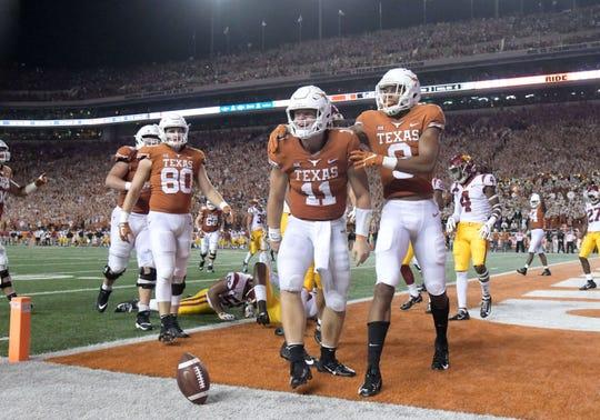 Texas quarterback Sam Ehlinger celebrates after scoring a touchdown against Southern California.