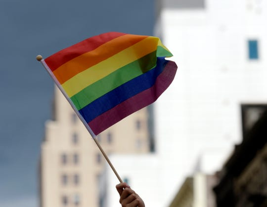 A participant waves a rainbow flag during the annual New York Pride March in New York, New York.