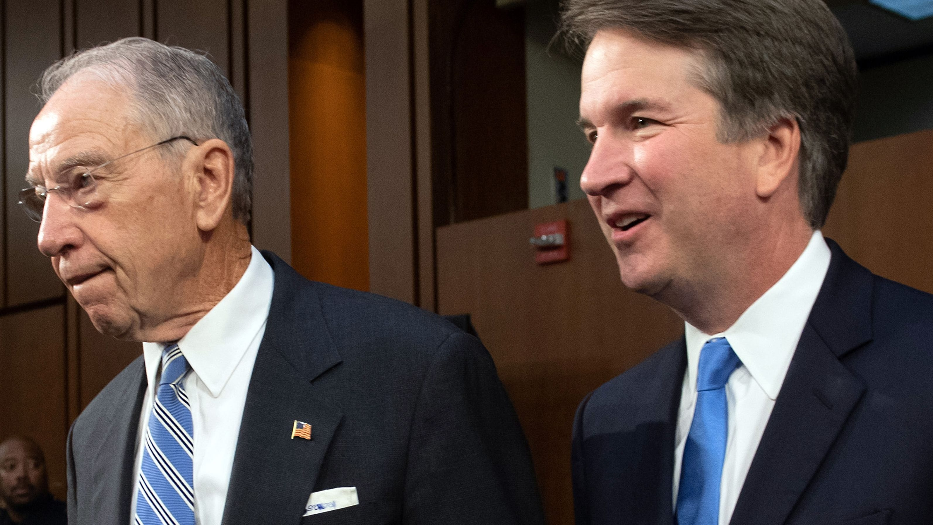Supreme Court nominee Brett Kavanaugh (right) is pictured walking alongside Sen. Chuck Grassley.