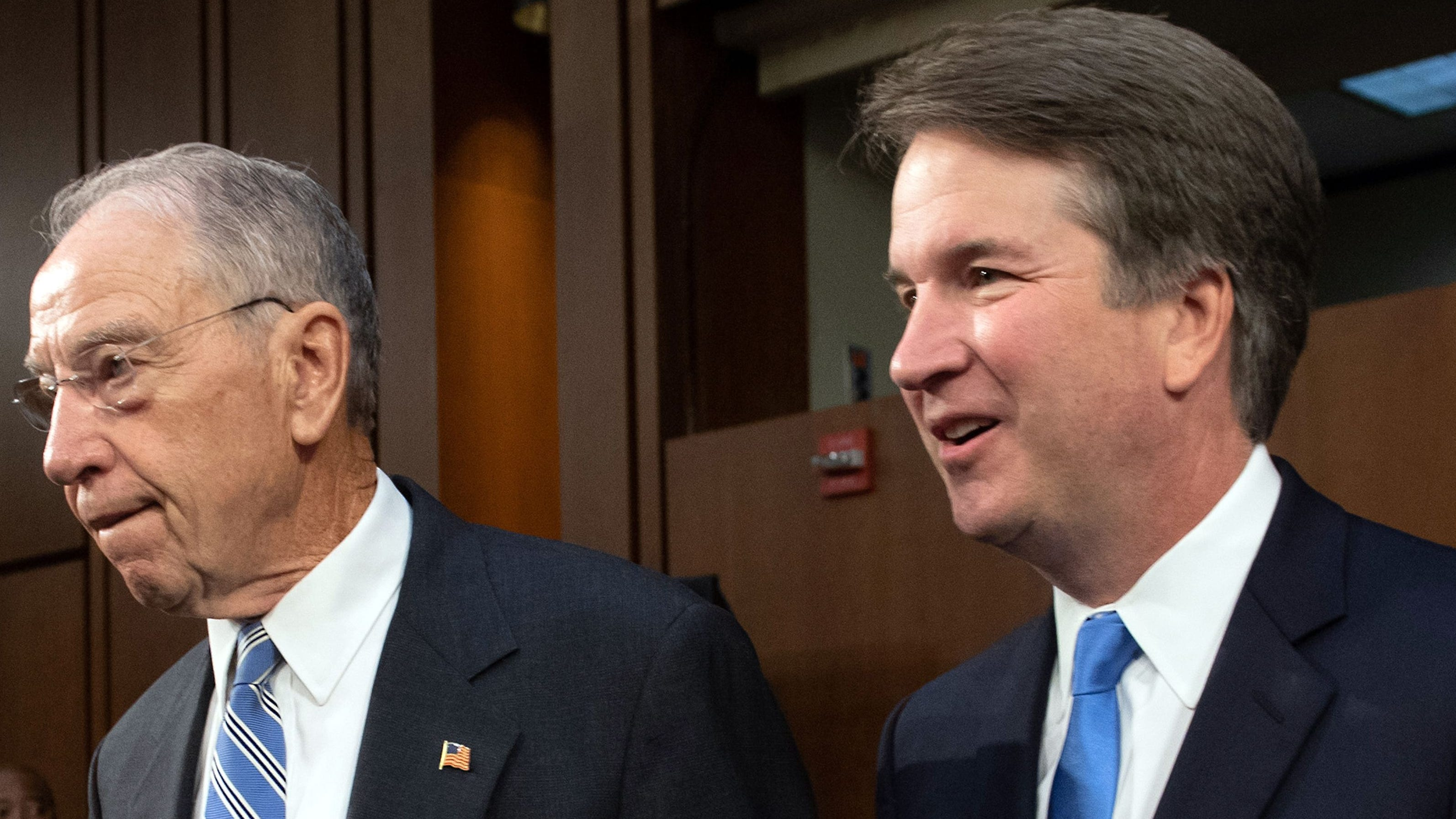 Supreme Court nominee Brett Kavanaugh (right) is pictured walking alongside Sen. Chuck Grassley.