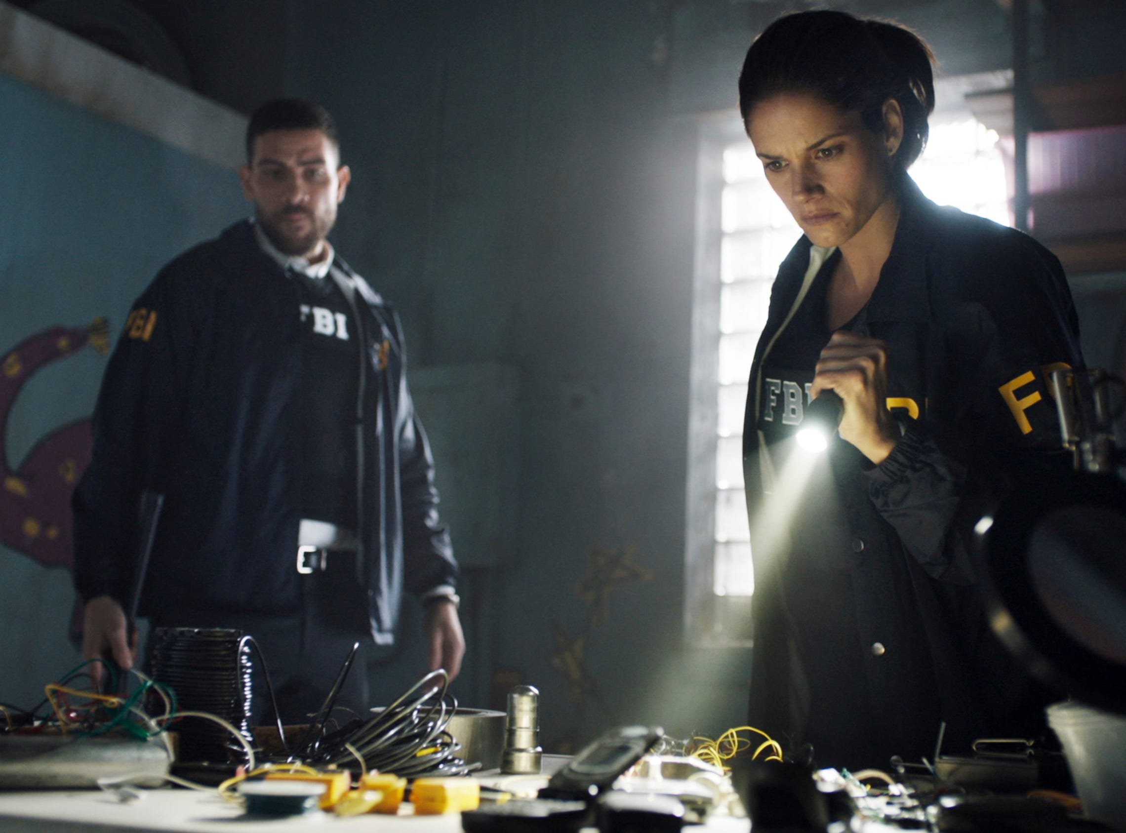 Missy Peregrym, right, and Zeeko Zaki, play special agents investigating federal crimes in New York in Dick Wolf's new CBS drama, 'FBI.'