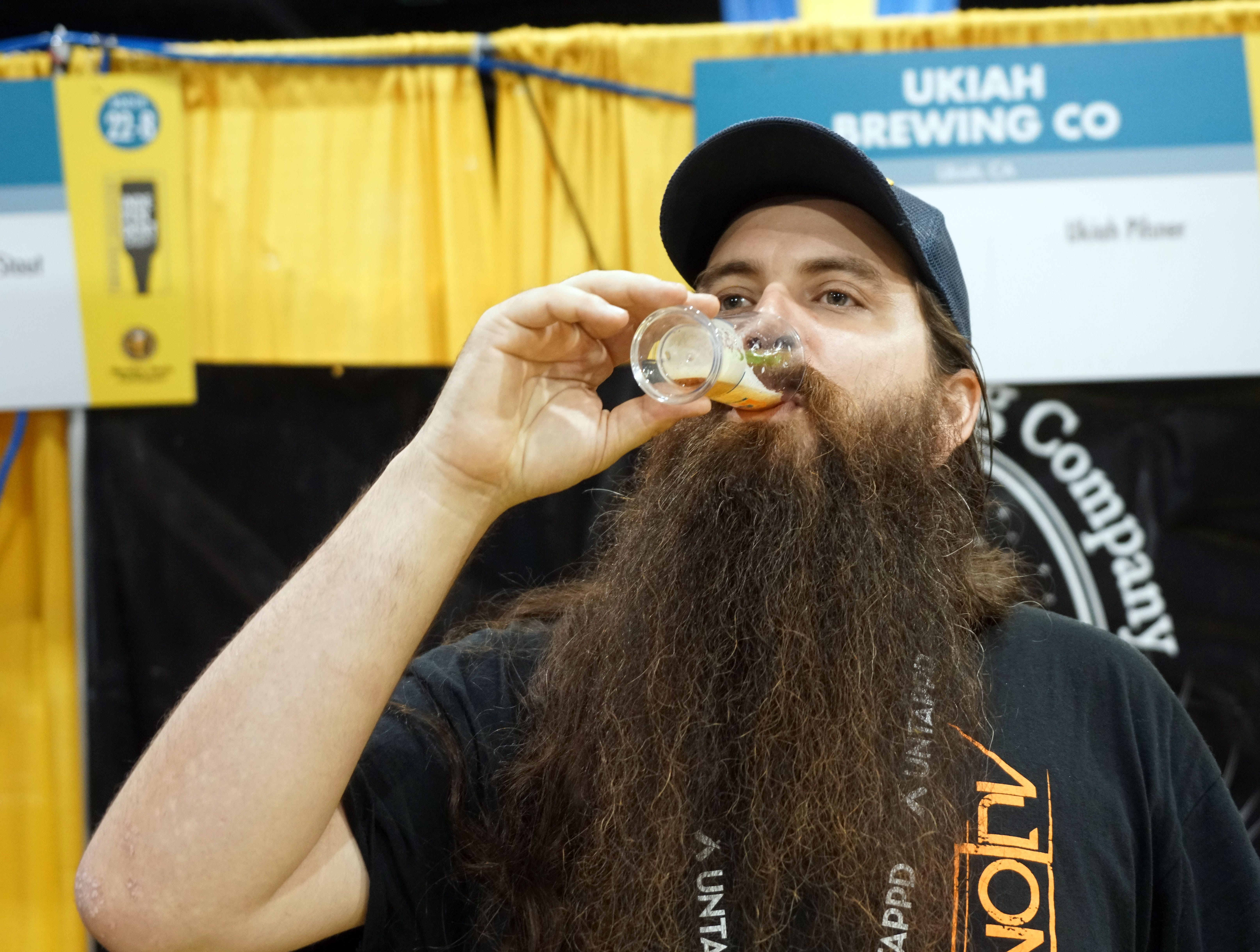 Scott Jones of Ukiah, Calif, tastes a beer during the Great American Beer Festival.