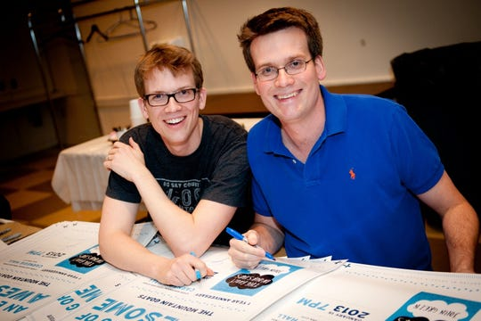 "Hank Green (left) with best-selling author brother John at Carnegie Hall in 2013. Hank says writing his debut book was ""so fun and scary and exciting."""