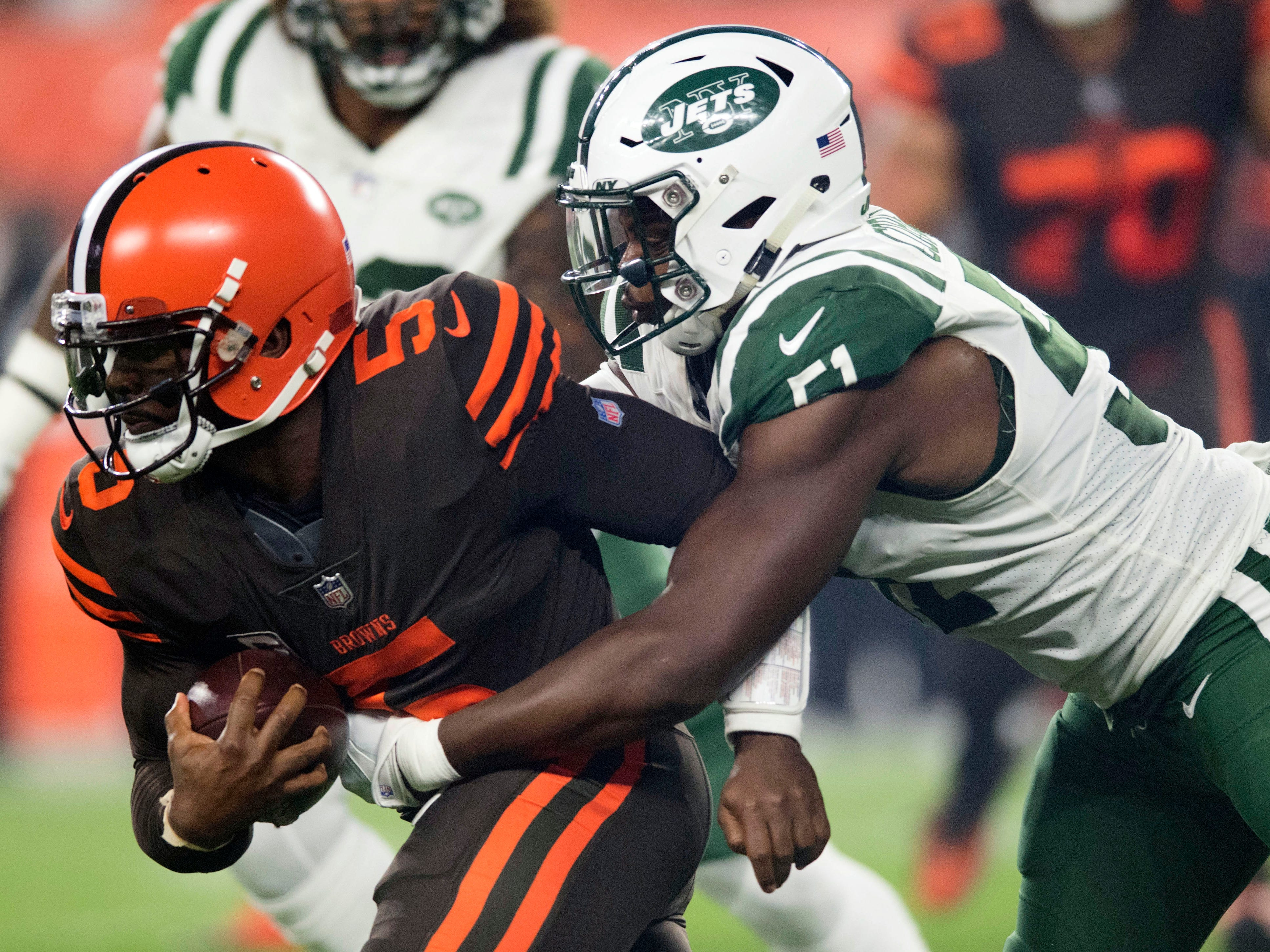 Cleveland Browns quarterback Tyrod Taylor is tackled by New York Jets linebacker Brandon Copeland during the first quarter at FirstEnergy Stadium.