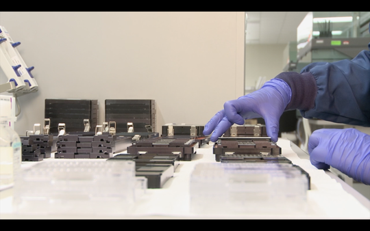 A worker at 23andMe performs DNA testing on samples provided by customers.