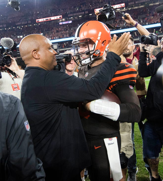 Cleveland Browns head coach Hue Jackson and quarterback Baker Mayfield celebrate after the Browns beat the New York Jets at FirstEnergy Stadium.