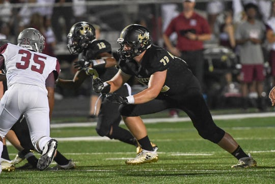 TL Hanna junior Jonathan Brown blocks during the first quarter at TL Hanna High School in Anderson on Friday, September 21, 2018.