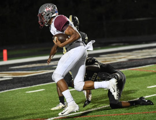 Westside sophomore Emelio Robinson scores by TL Hanna junior Melakai Tate for a rushing touchdown during the fourth quarter at TL Hanna High School in Anderson on September 21, 2018.