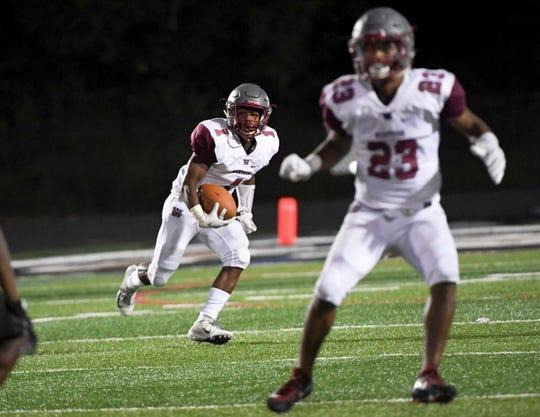 Westside senior Traye Carson runs during the fourth quarter at TL Hanna High School in Anderson on September 21, 2018.