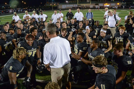 TL Hanna head coach Jeff Heron talks with players after the game at TL Hanna High School in Anderson on September 21, 2018.