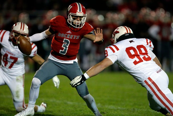 Peter Biolo, front, and Tristan Argall of Kimberly close on Sam Dietrich of Neenah in a Valley Football Association game Friday, September 21, 2018, at Rocket Stadium in Neenah, Wis.Ron Page/USA TODAY NETWORK-Wisconsin