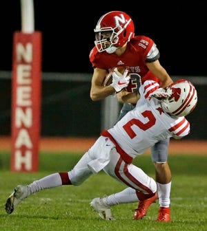 Drew Lechnir of Kimberly tackles Logan Morrow of Neenah in a Valley Football Association game Sept. 21 at Rocket Stadium in Neenah. Kimberly and Neenah are two of eight teams that have qualified for the WIAA postseason in Post-Crescent coverage area. Ron Page/USA TODAY NETWORK-Wisconsin