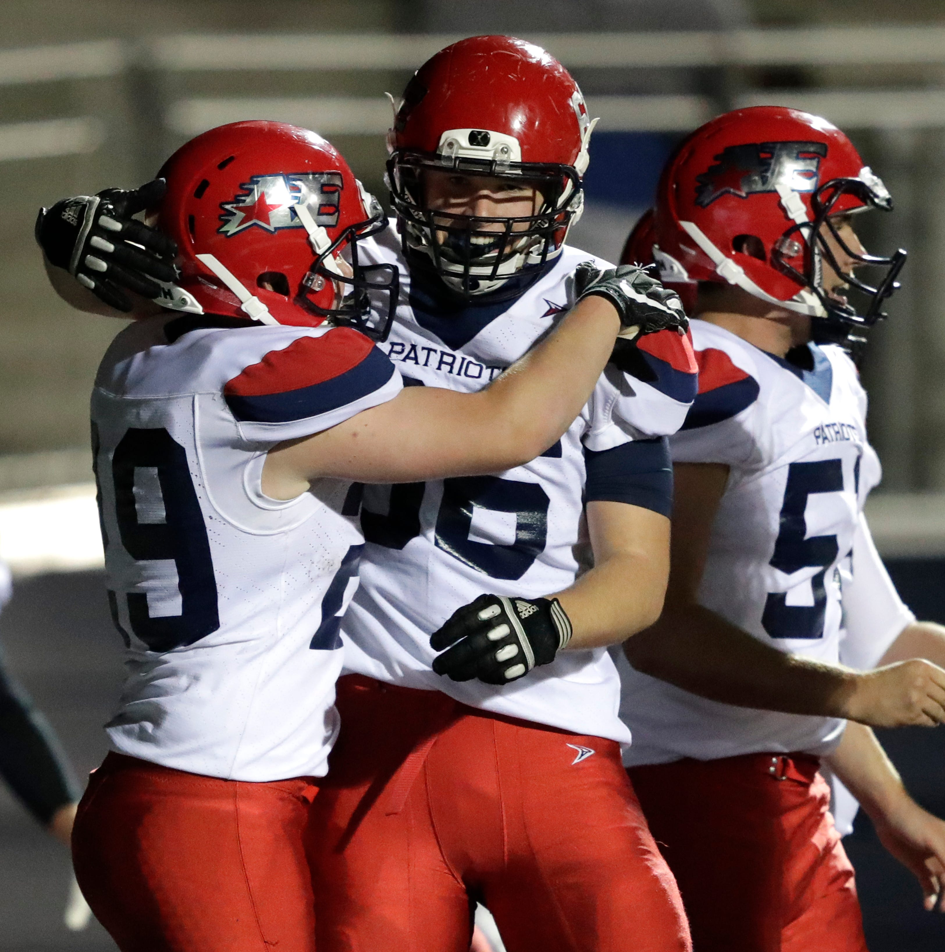 Appleton East High School's Alec Goland, left, celebrates scoring the game-winning touchdown in double overtime with teammate Mitchell West against Appleton West High School during their football game Friday, Sept. 21, 2018, at the Banta Bowl in Appleton, Wis. The score was the game-winning touchdown.Dan Powers/USA TODAY NETWORK-Wisconsin