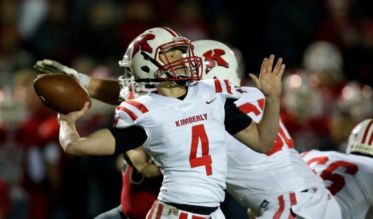Cody Staerkel of Kimberly passes against Neenah during Friday's game.  Ron Page/USA TODAY NETWORK-Wisconsin
