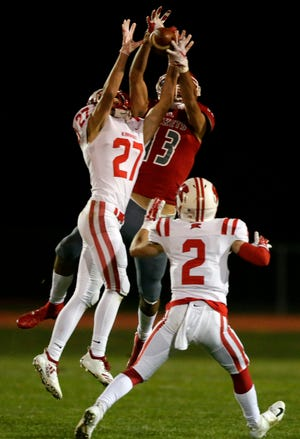 Trey Tennessen of Kimberly intercepts a pass intended for Logan Morrow of Neenah in a nonconference football game Friday at Rocket Stadium in Neenah. Ron Page/USA TODAY NETWORK-Wisconsin