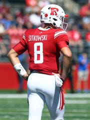 Rutgers quarterback Artur Sitkowski wears the initials and number of friend and former Old Bridge High School baseball star Zach Attianese, who was killed in a June car accident.