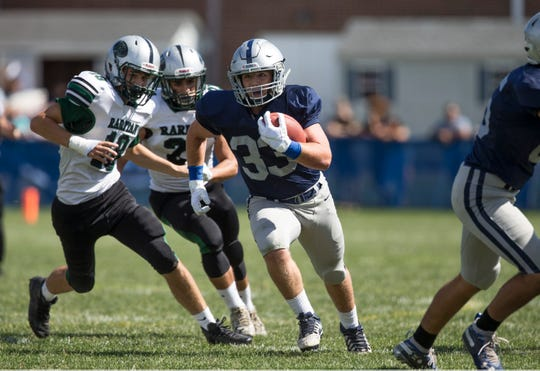 Manasquan's Canyon Birch runs to the end zone for a touchdown as the Warriors played Raritan on Saturday, Sep. 22, 2018