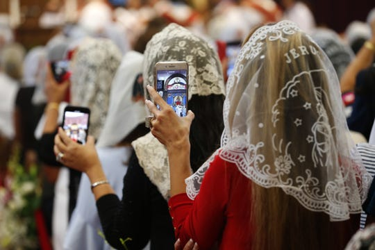 Parishioners take photos of Pope Tawadros II during his visit to St. Mina's Coptic Orthodox Church in Holmdel, N.J., on Sept. 22, 2018.