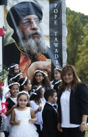 Parishioners wait for the arrival of Pope Tawadros II at St. Mina's Coptic Orthodox Church in Holmdel  Saturday, September 22, 2018.