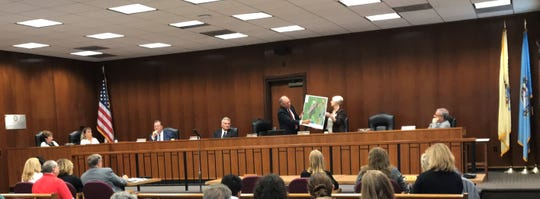 Ocean County Freeholder Director Gerry P. Little and Freeholder Virginia E. Haines display a map of the Forked River Mountains at Wednesday's public hearing about the board's $15.5 million planned acquisition of the 7,860-acre wilderness site.