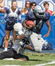 Manasquan's Rashid Tuddles tries to shake loose from a tackle on Saturday, Sep. 22, 2018 when the Warriors played Raritan.