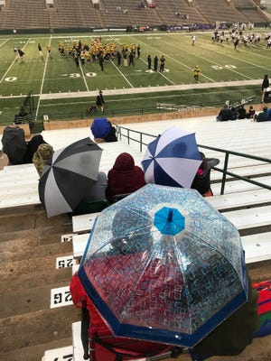 A few hardy fans wait in the rain for Abilene High's homecoming at Shotwell Stadium on Friday, Sept. 21, 2018. The Eagles are hosting the Midland High Bulldogs.