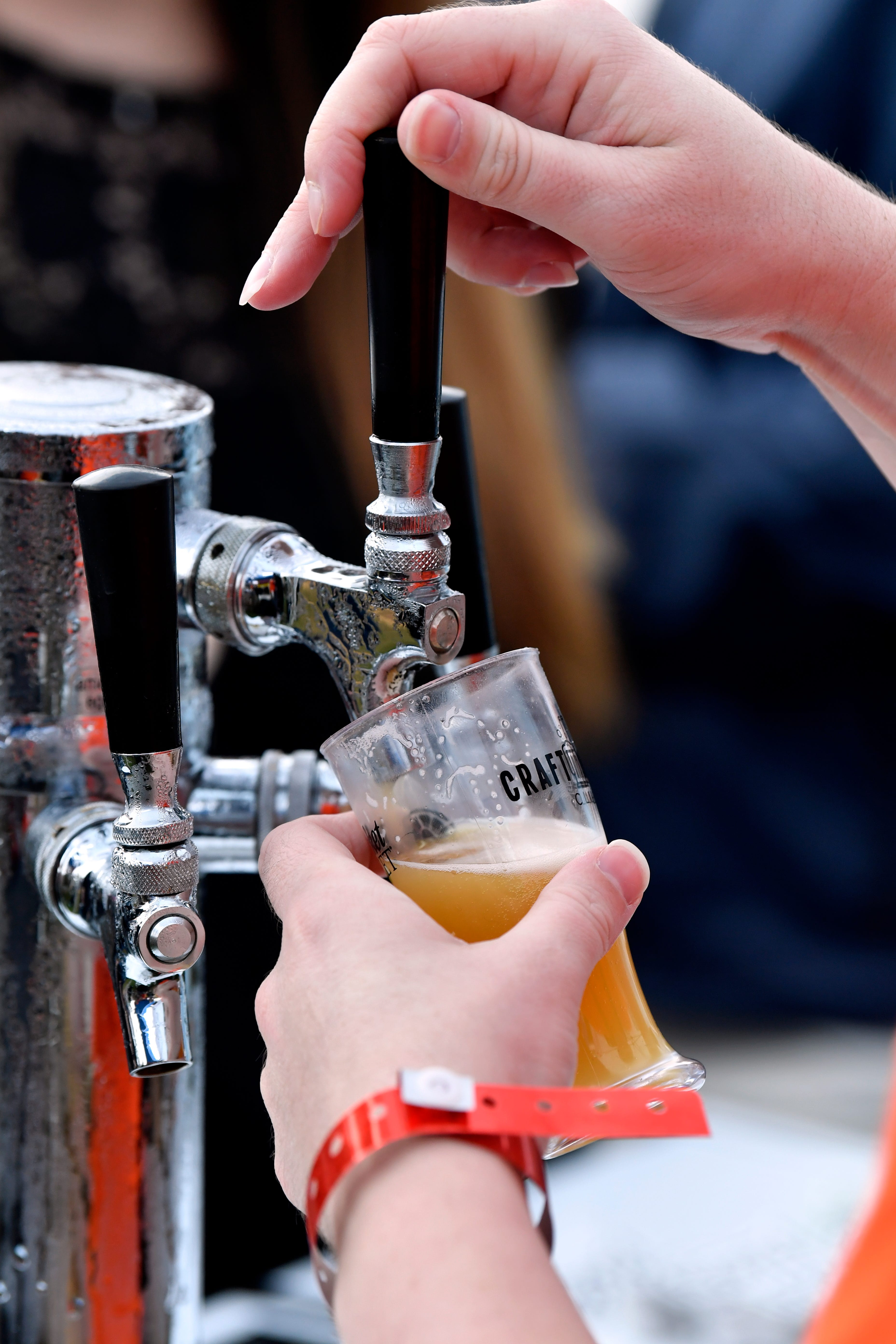 A sample glass is filled at the Grain Theory tent during Saturday's Abilene Beer Summit.