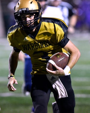 Abilene High quarterback Kallin Sipe scrambles with the ball during Friday's game against Midland High Sept. 21, 2018. Abilene won, 13-0.
