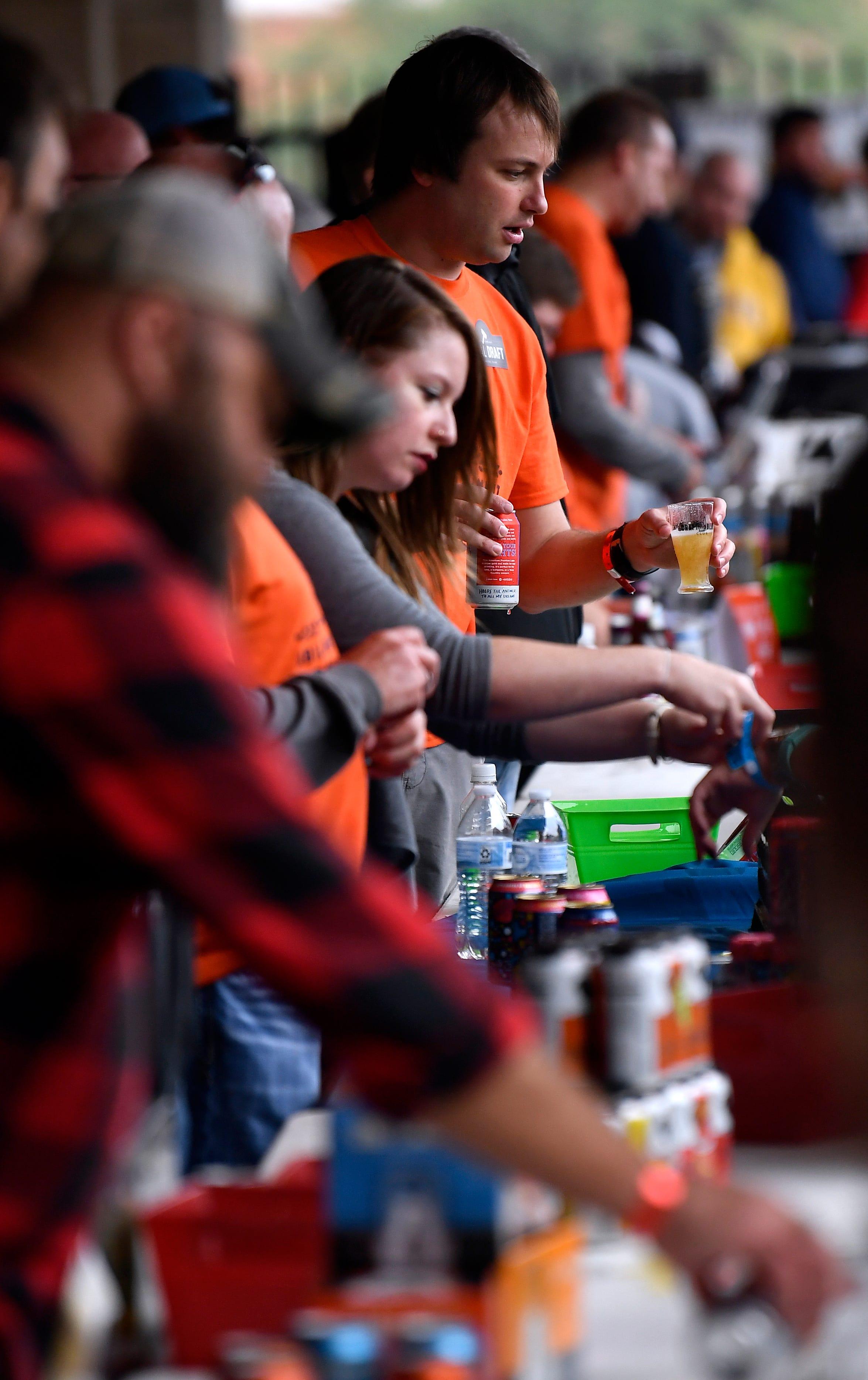 Matt Thaxton and Rachel Acosta serve customers during Saturday's Abilene Beer Summit.
