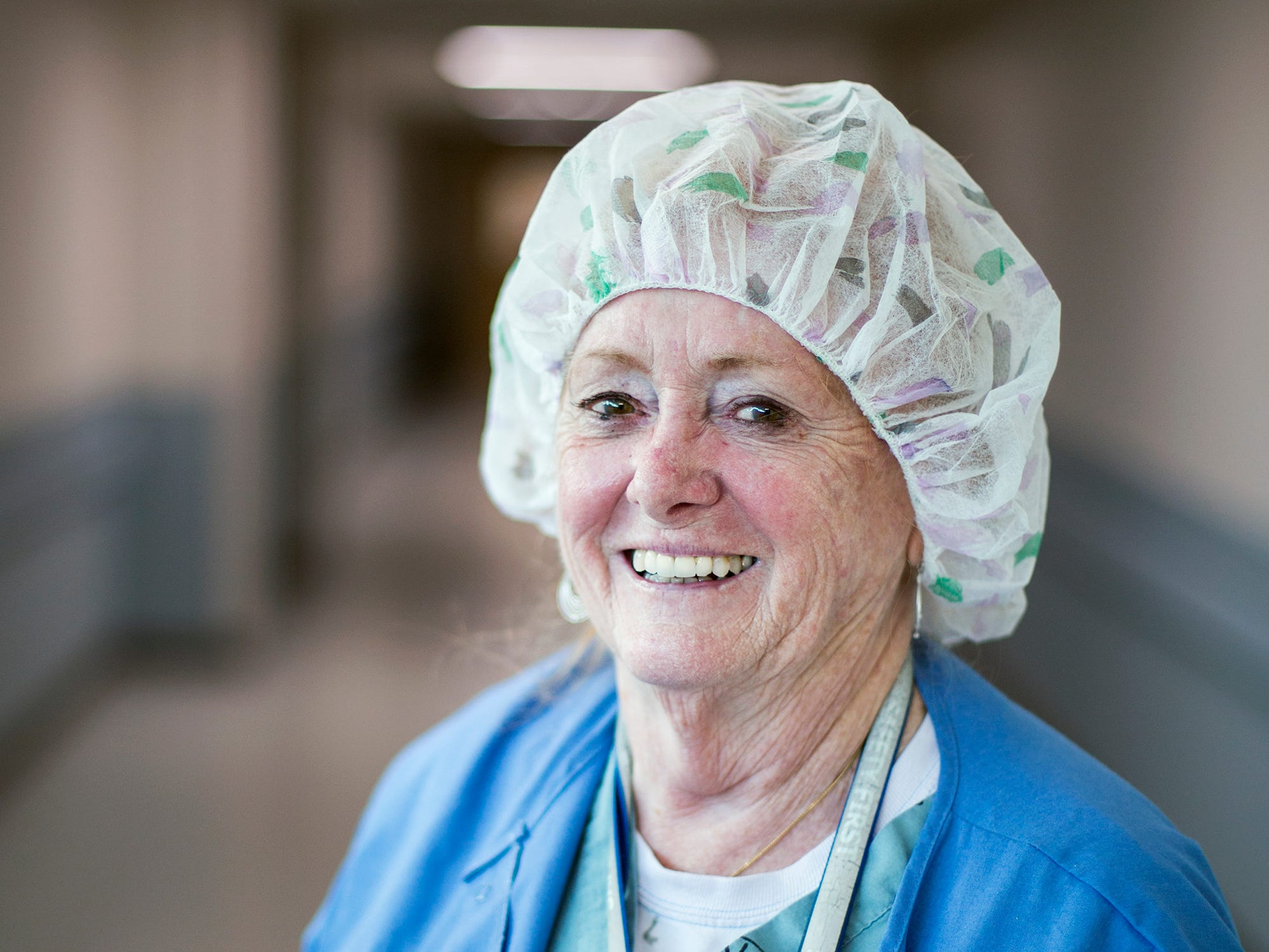 Mickey Donathan, certified registered nurse anesthetist at the Charles George VA Medical Center, stands in the hallway outside the operating wing on one of her last days at work, Thursday, Sept. 20, 2018. Donathan, 76, has been a nurse in the Asheville area for 55 years, serving three hospitals, training hundreds of anesthesia students and caring for thousands upon thousands of patients.