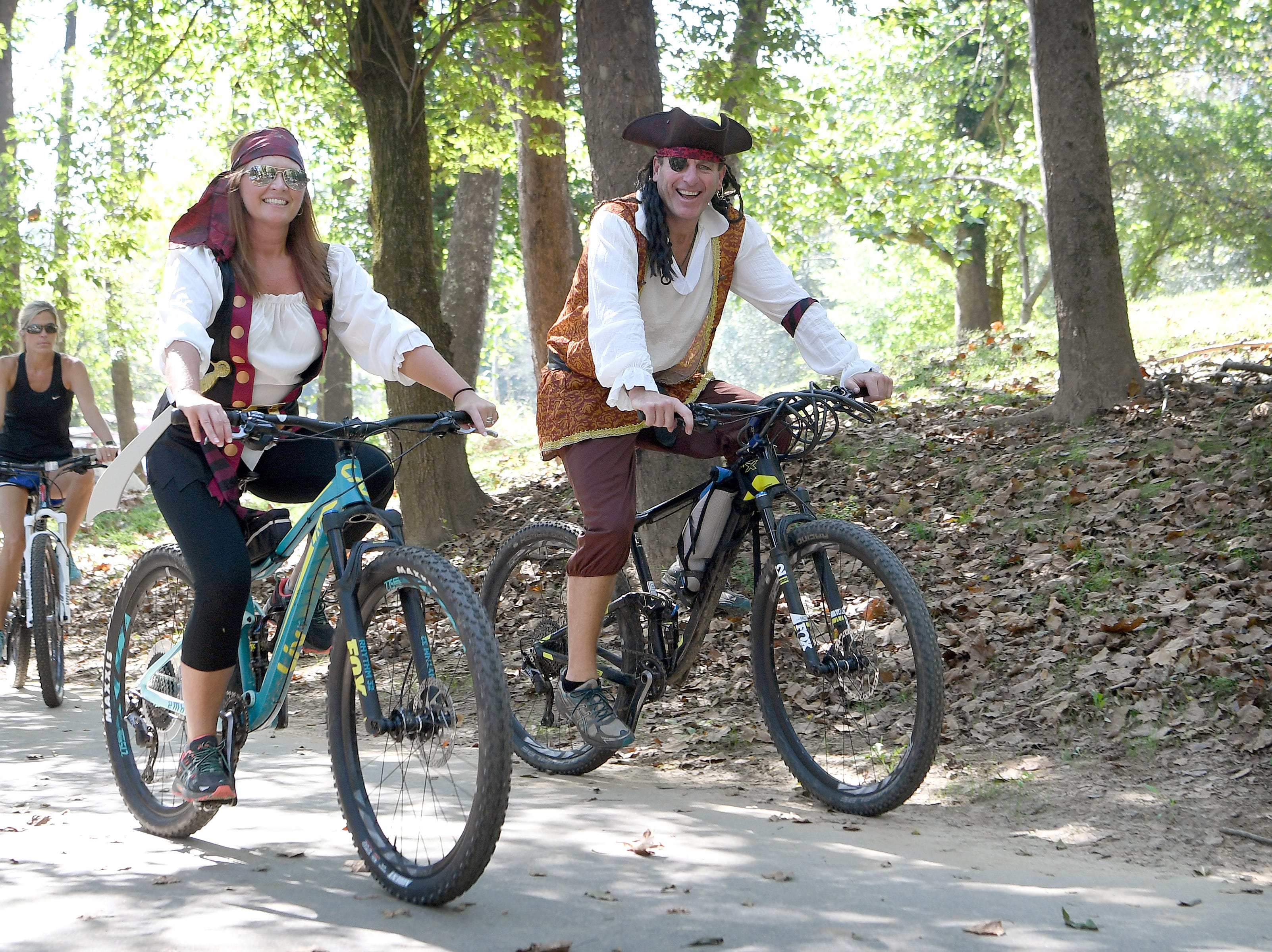 Robin and Steve Walker wear their best pirate garb as they make their way down the greenway in the Asheville on Bikes and New Belgium Tour de Fat Bike Parade on Sept. 22, 2018.