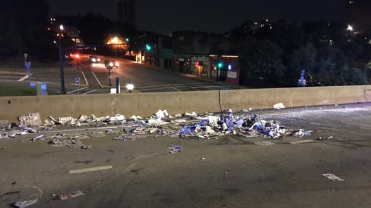 Newspapers strewn about the I-240 overpass near Merrimon Avenue.