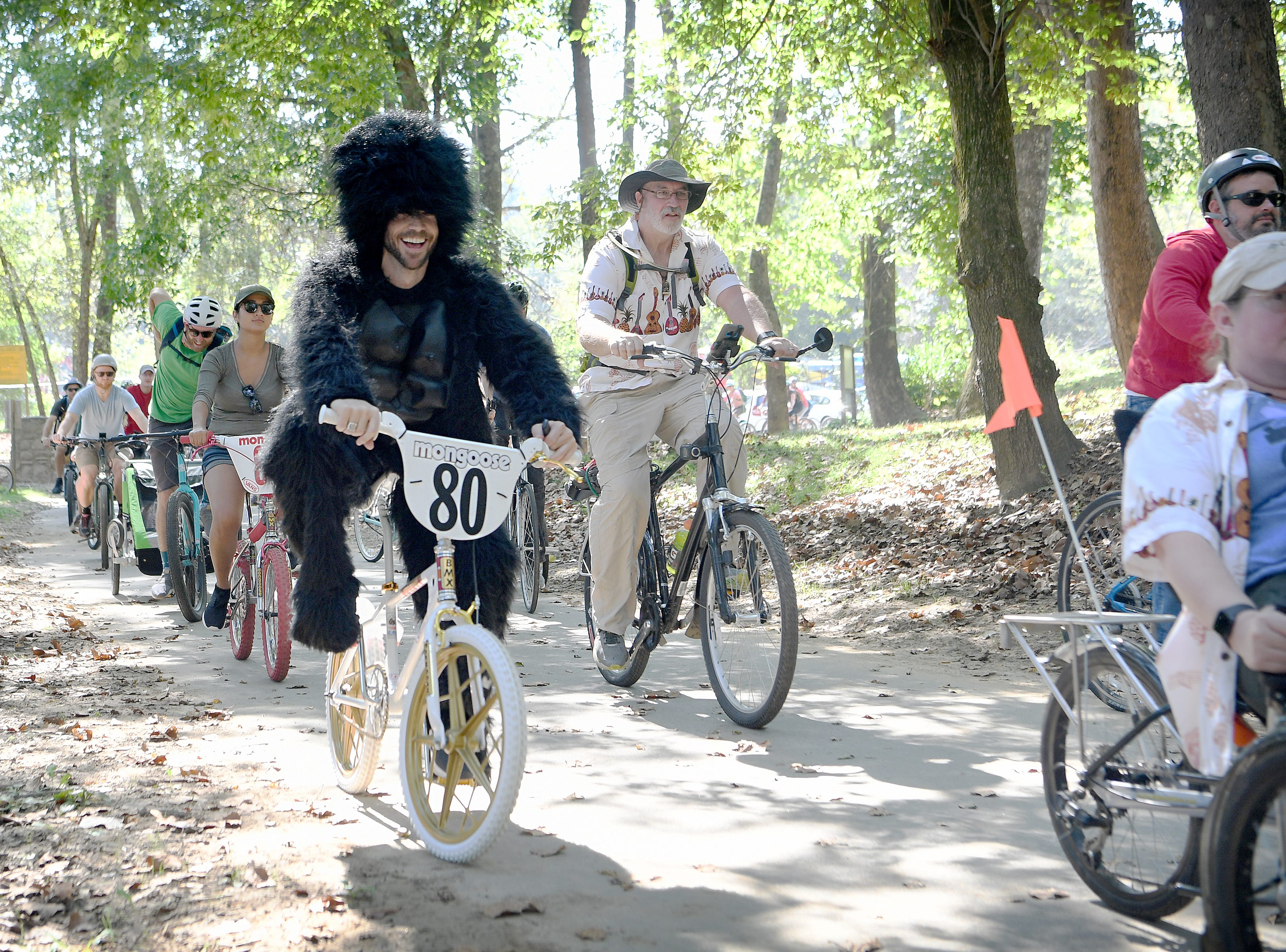 Danny Van Acker dons a gorilla suit as he rides in the Asheville on Bikes and New Belgium Tour de Fat Bike Parade on Sept. 22, 2018.
