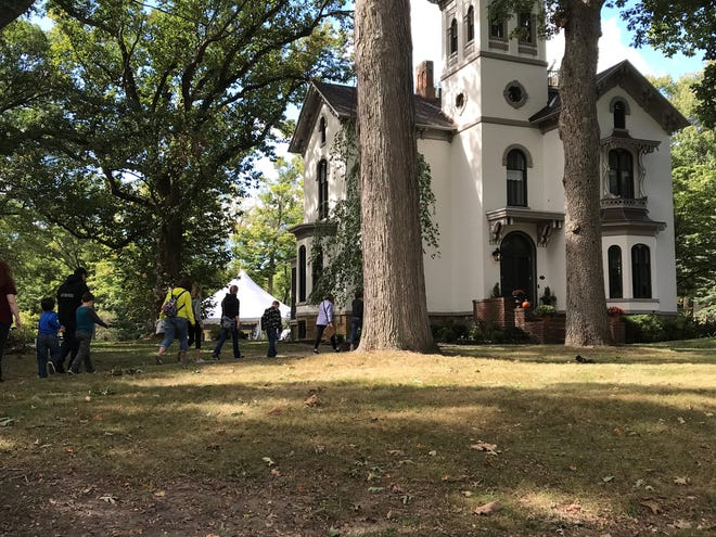 People from near and far came to Marshall on Saturday to see some of the famous sites in John Bellairs' books, especially the real house with a clock in its walls, the Cronin house.