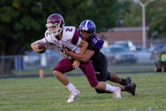 Lakeview's Tayvon Hughes (32) sacks Kalamazoo Central quarterback Jacob Lyle (2) in the second quarter of play on Friday, September 21, 2018.