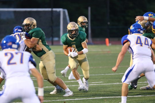 Matt Thrasher from Vestal looks for running room against the M-E Defense
