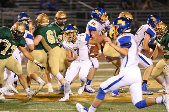 Maine-Endwell quarterback Joe Mancini finds running room against Vestal on Friday night at Dick Hoover Stadium. Mancini threw two touchdown passes in the Spartans' 38-32 victory.
