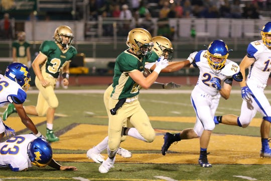 Adam Mieczkowski from  Vestal tries to elude the ME defense