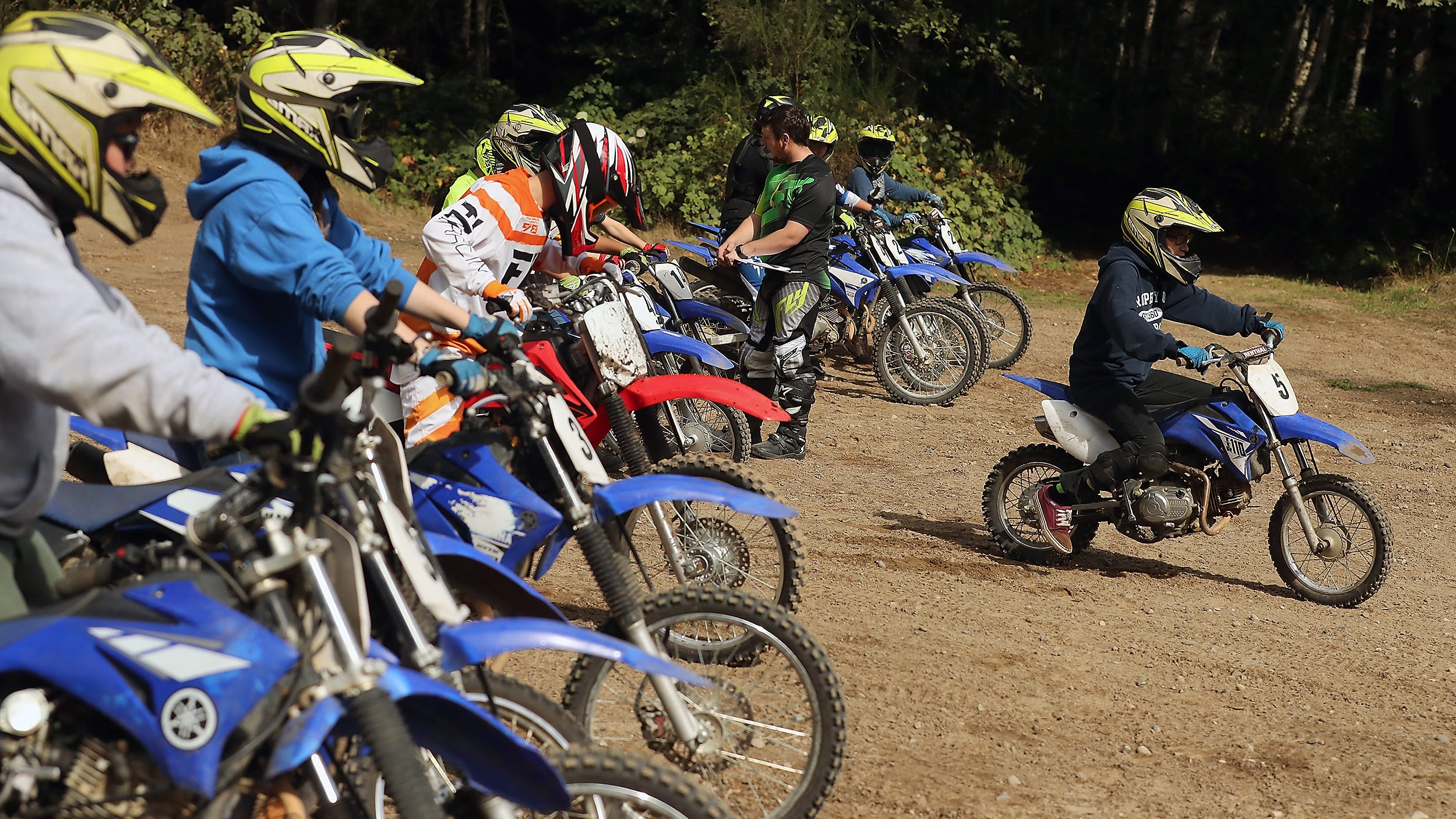Luke Burrier, 14, (front) takes off from the line of bikes and heads out on the Moto-X course at Island Lake Camp on Saturday, September 22, 2018.