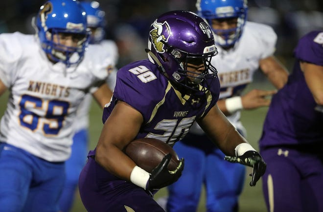 North Kitsap's Isaiah Kahana carries the ball down the field against Bremerton on Friday, September 21, 2018.