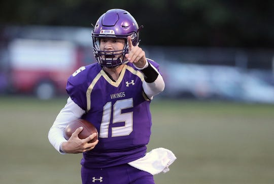 North Kitsap's Andrew Blackmore and the Vikings are headed in the right direction after beating Bremerton 49-0 on Friday.