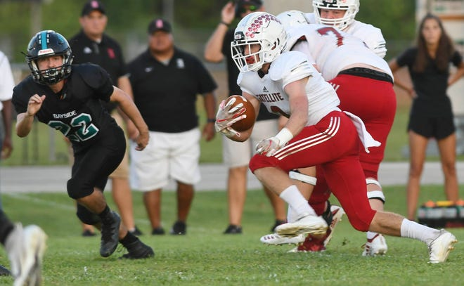 Satellite's Beau Cole looks for running room during Friday's game against Bayside